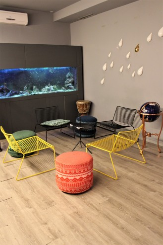 The lounge area at the Tattva Desing Hostel in Porto is just made for meeting new people .