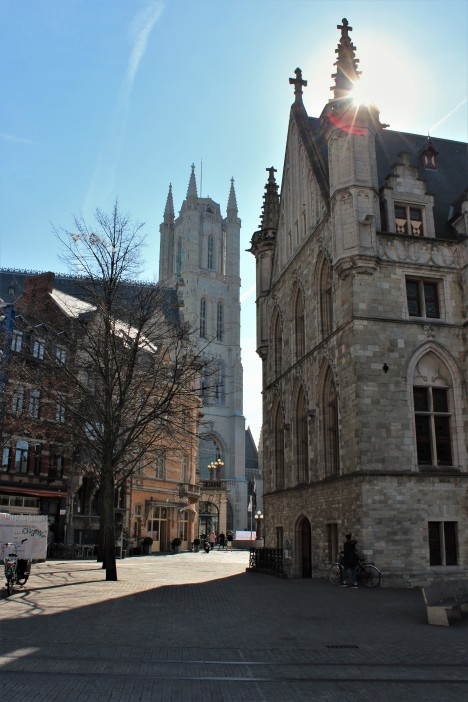 A typical chruch in Ghent with the sun peaking through.